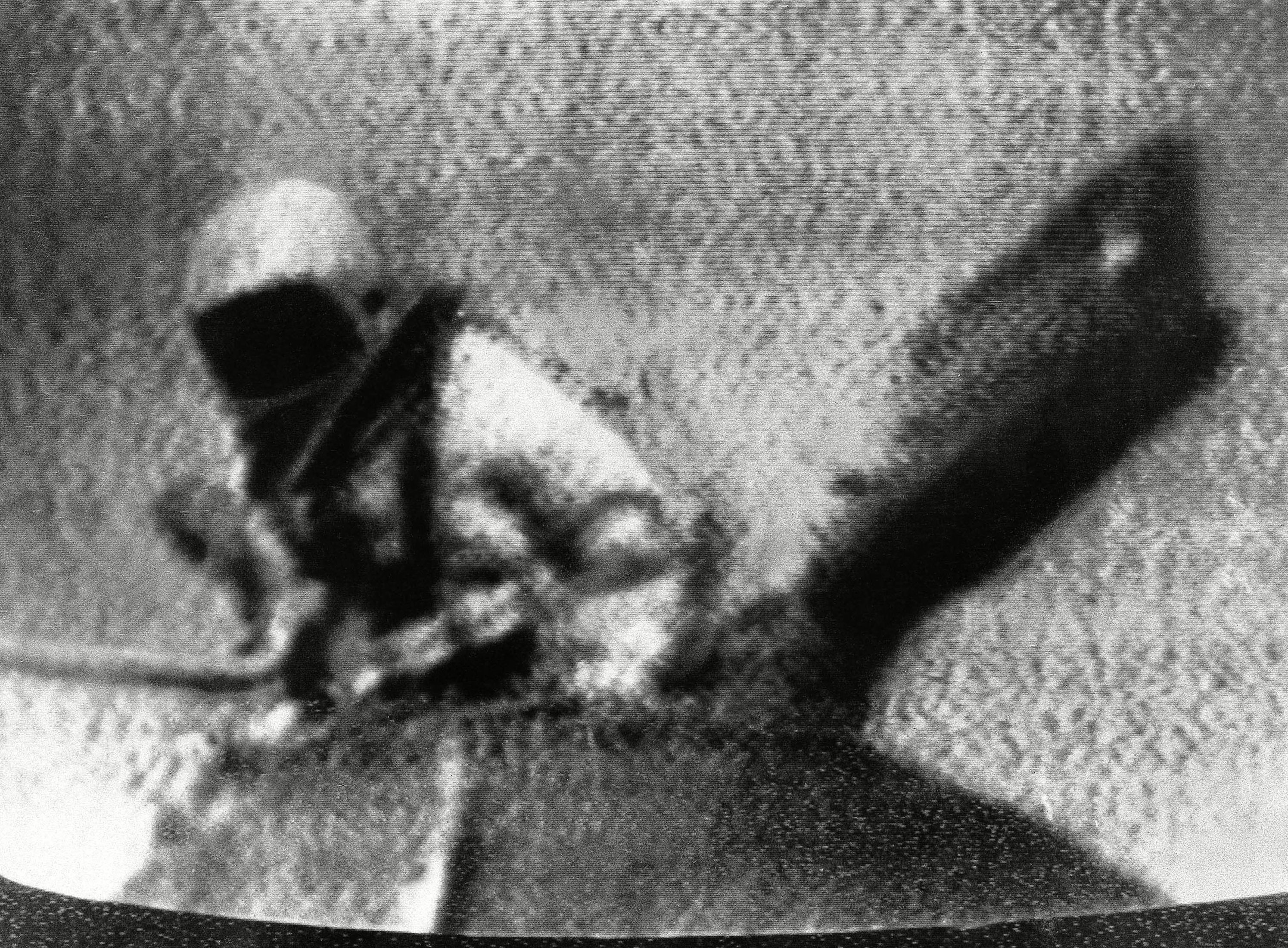 Soviet cosmonaut Lt. Col. Alexei Leonov, figure at left, leaves spaceship Woskhod - 2 to become the first man to step into outer space. Projection on right holds movie camera. This photo was taken in Moscow off Russian television. Moscow radio reported night that the spaceship had reappeared over Soviet Territory, indicating it had completed 13 orbits Russian Cosmonaut, In Space