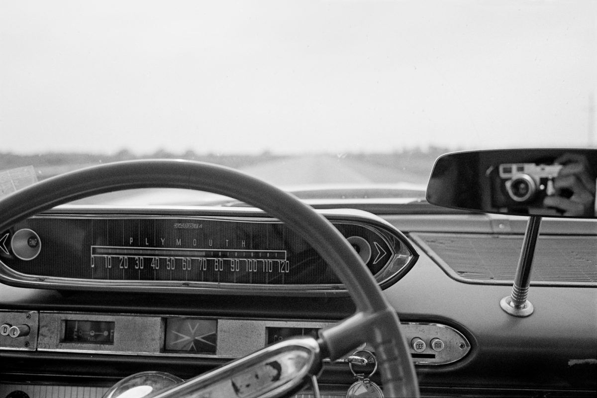 Sort of a self-portrait. This car had one of the coolest speedometers ever designed. Cruising at 70mph across the Great Plains.