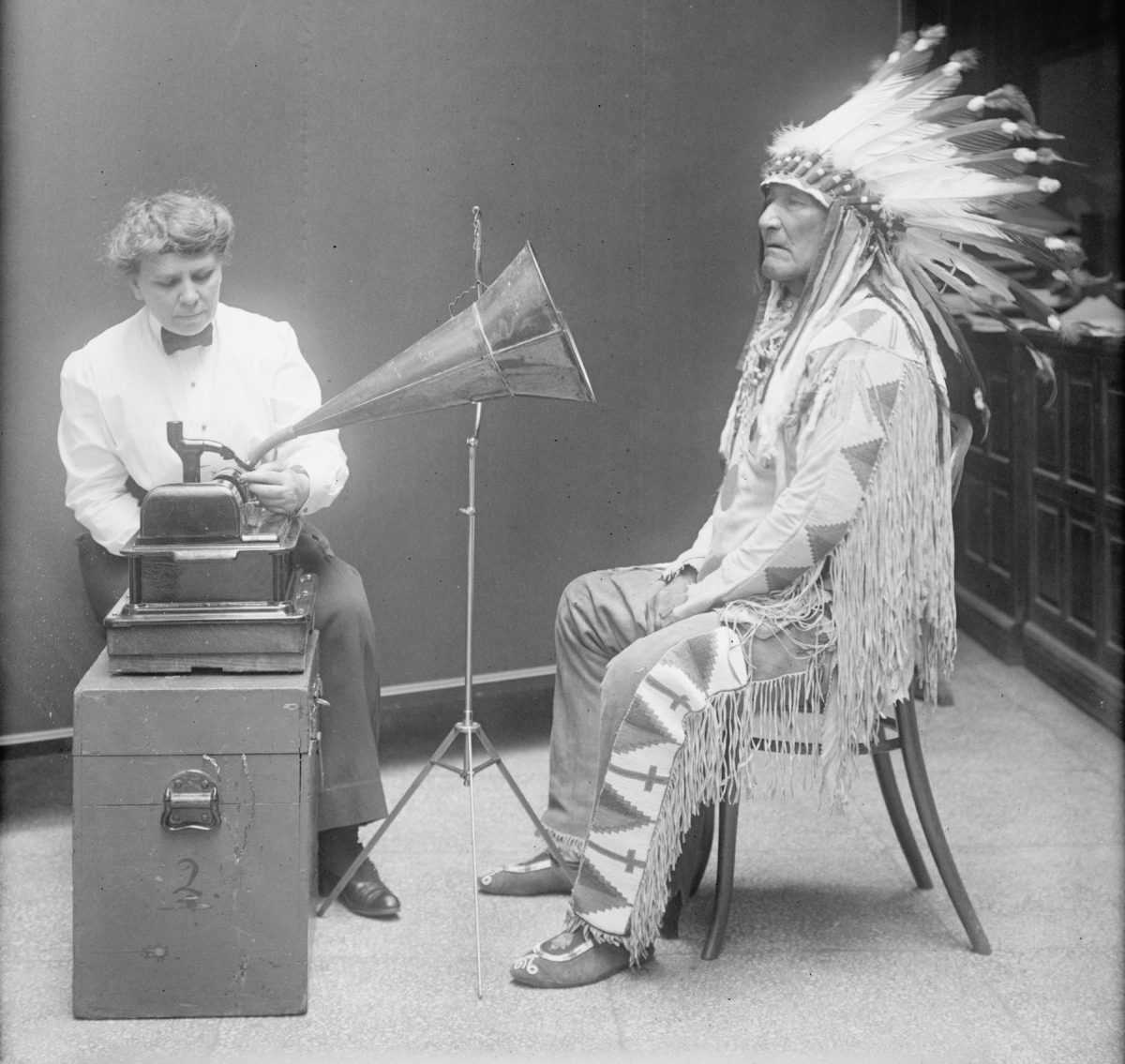American anthropologist and ethnographer Frances Densmore records the Blackfoot chief Mountain Chief in 1916 for the Bureau of American Ethnology. Library of Congress.