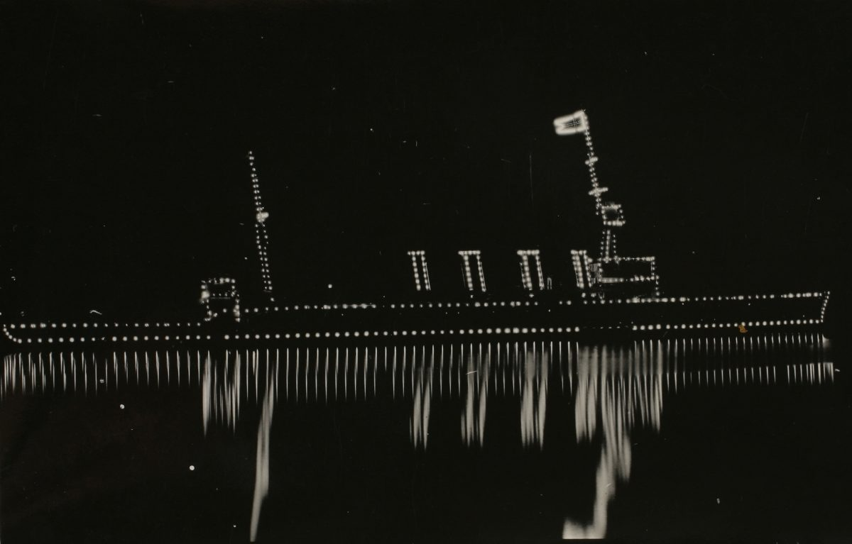 HMAS Sydney illuminated at night