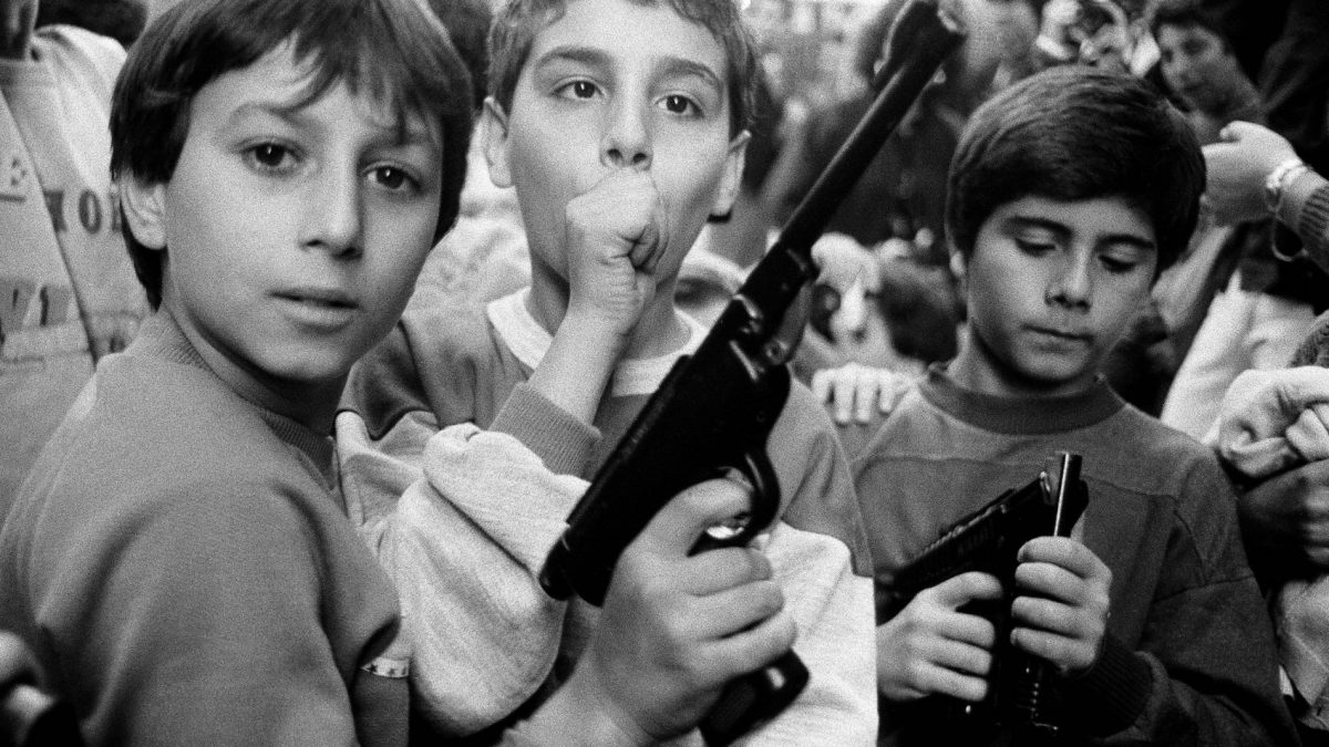 Three young boys holding guns mafia Sicily Italy