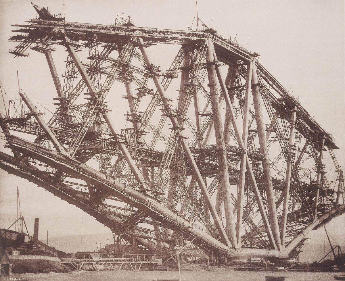 Forth Railway Bridge, Scotland: the Fife cantilever under construction during October 1888. This was the first steel bridge, and was built with tubes fabricated from sheet steel produced by the Siemens-Martin process. It carried the railway across the Firth of Forth near Edinburgh. Designed by the British civil engineers John Fowler (1817-1898) and Benjamin Baker (1840-1907). Opened in 1890. Photograph