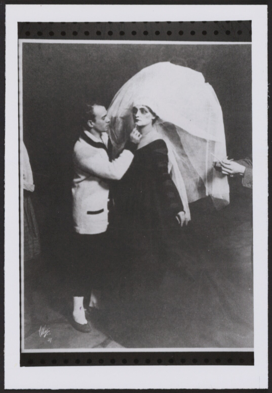 Nijinsky applies makeup to a performer, 1916