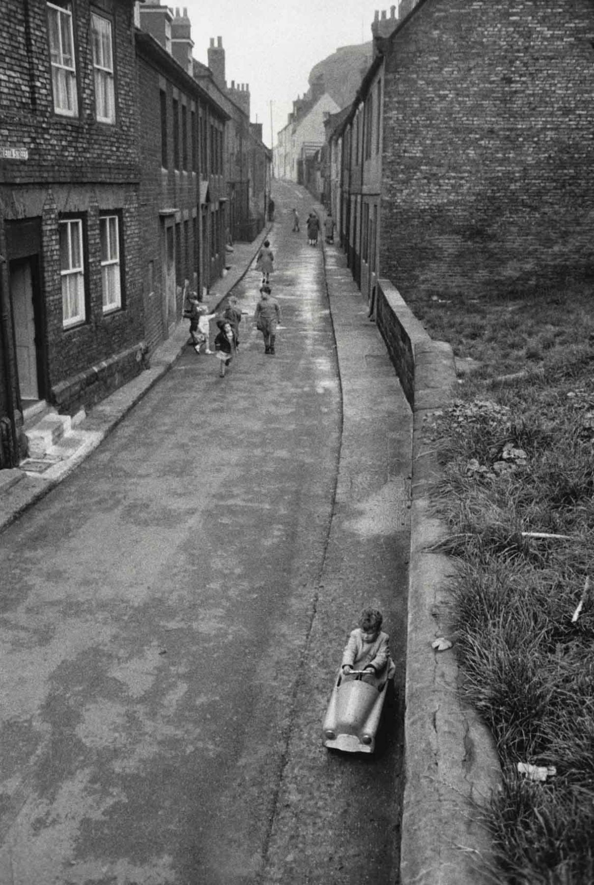 Child Riding in Toy Car, England, 1960 Bruce Davidson