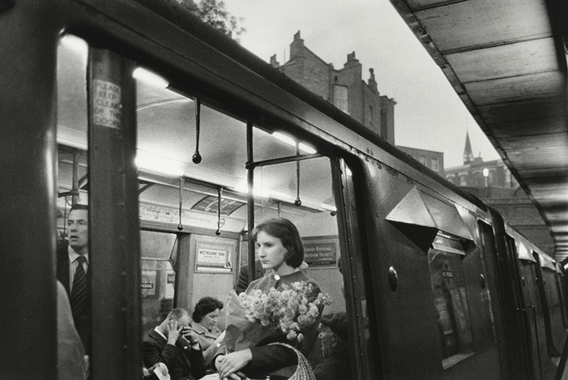 Woman on Tube Holding Flowers, London, England, 1960 Bruce Davidson