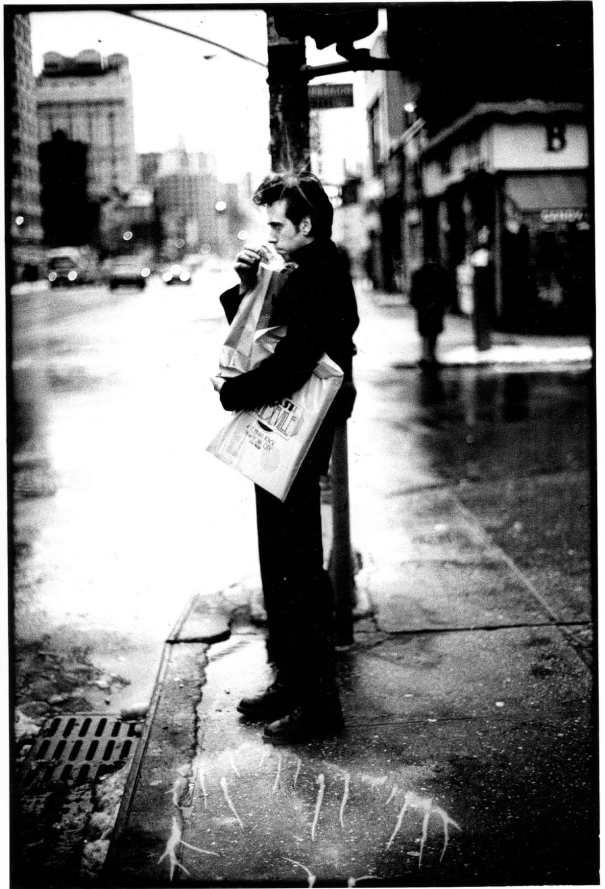 Mick Jones standing on a New York streetcorner