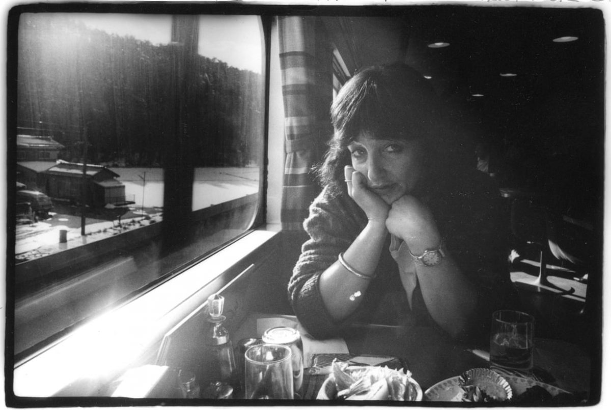 Pennie Smith seated on a moving train