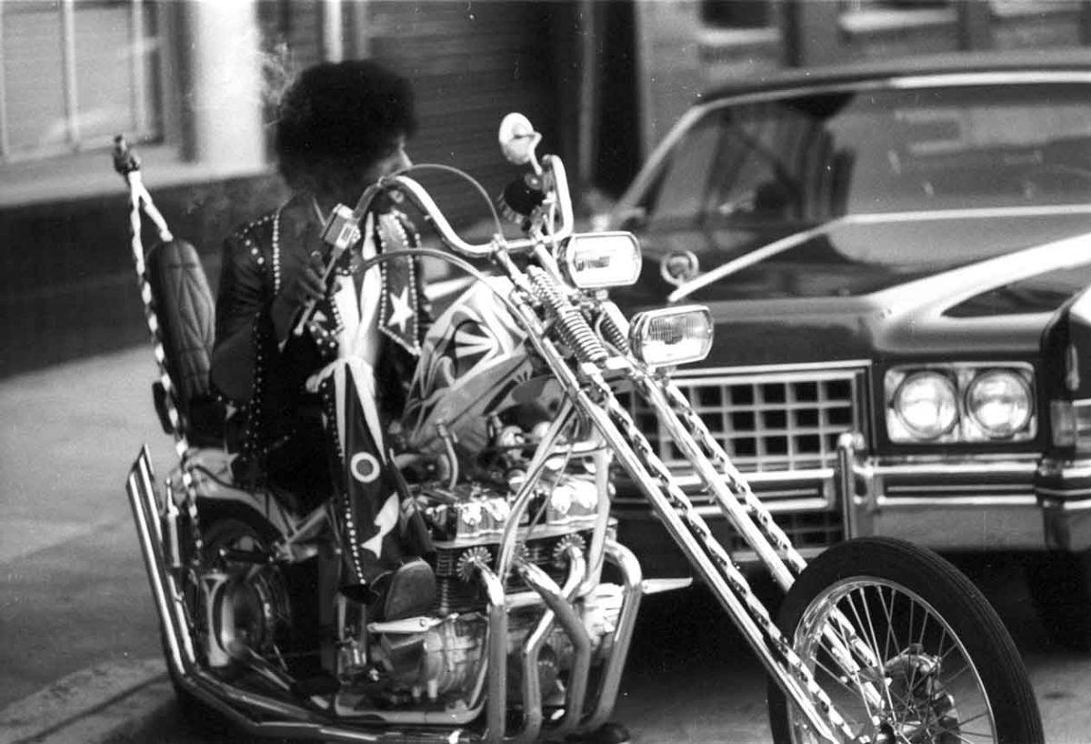 Sly Stone rides his chopper