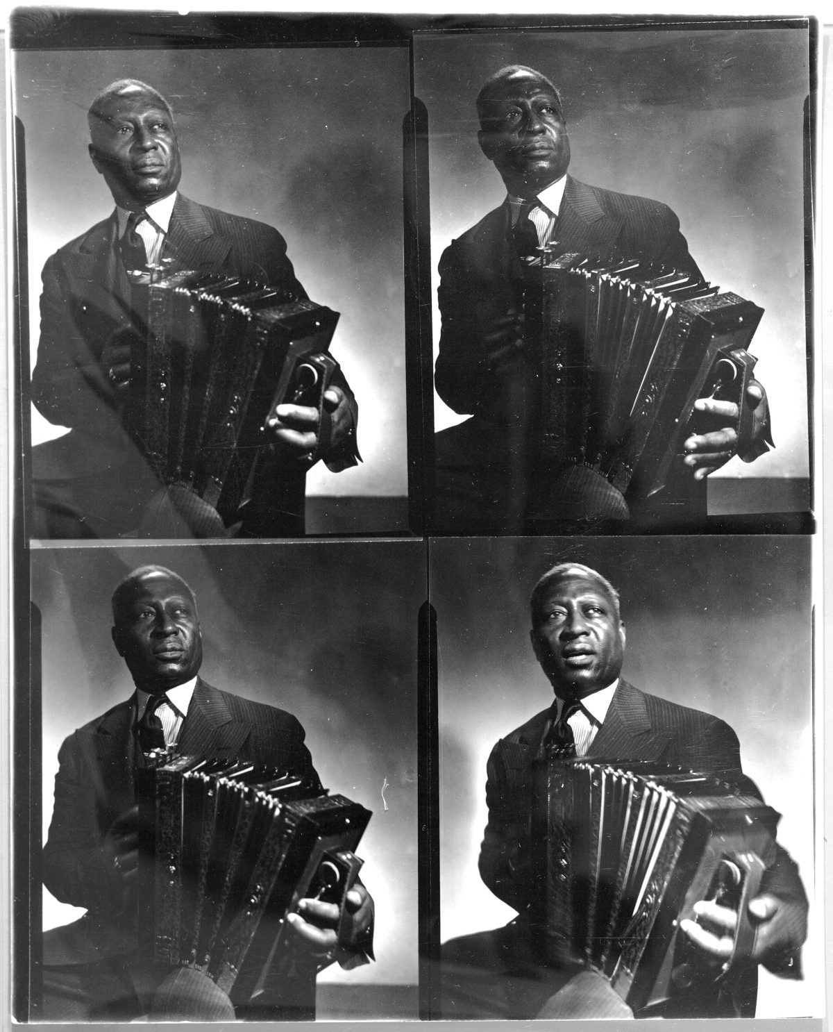 Contact sheet with 4 frames of Leadbelly posing with an accordion