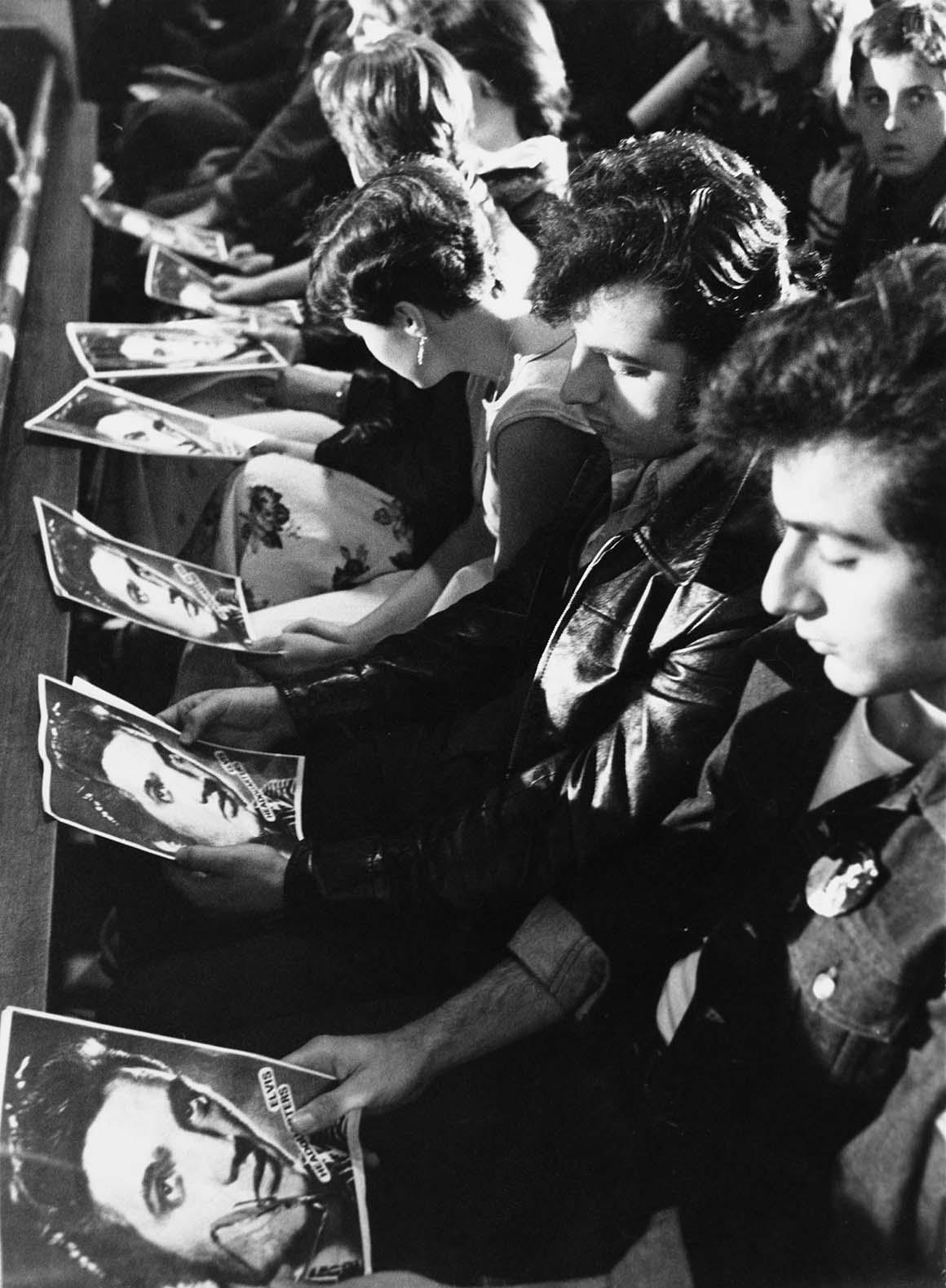 Fans with special prayer sheets at a memorial service for Elvis Presley held in London just after the singer's death on the 16th August 1977.
