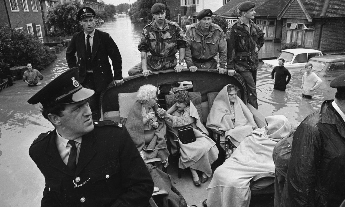 Patients from Molesey Cottage Hospital who were rescued by police and soldiers during flooding in Surrey, 17 August 1968