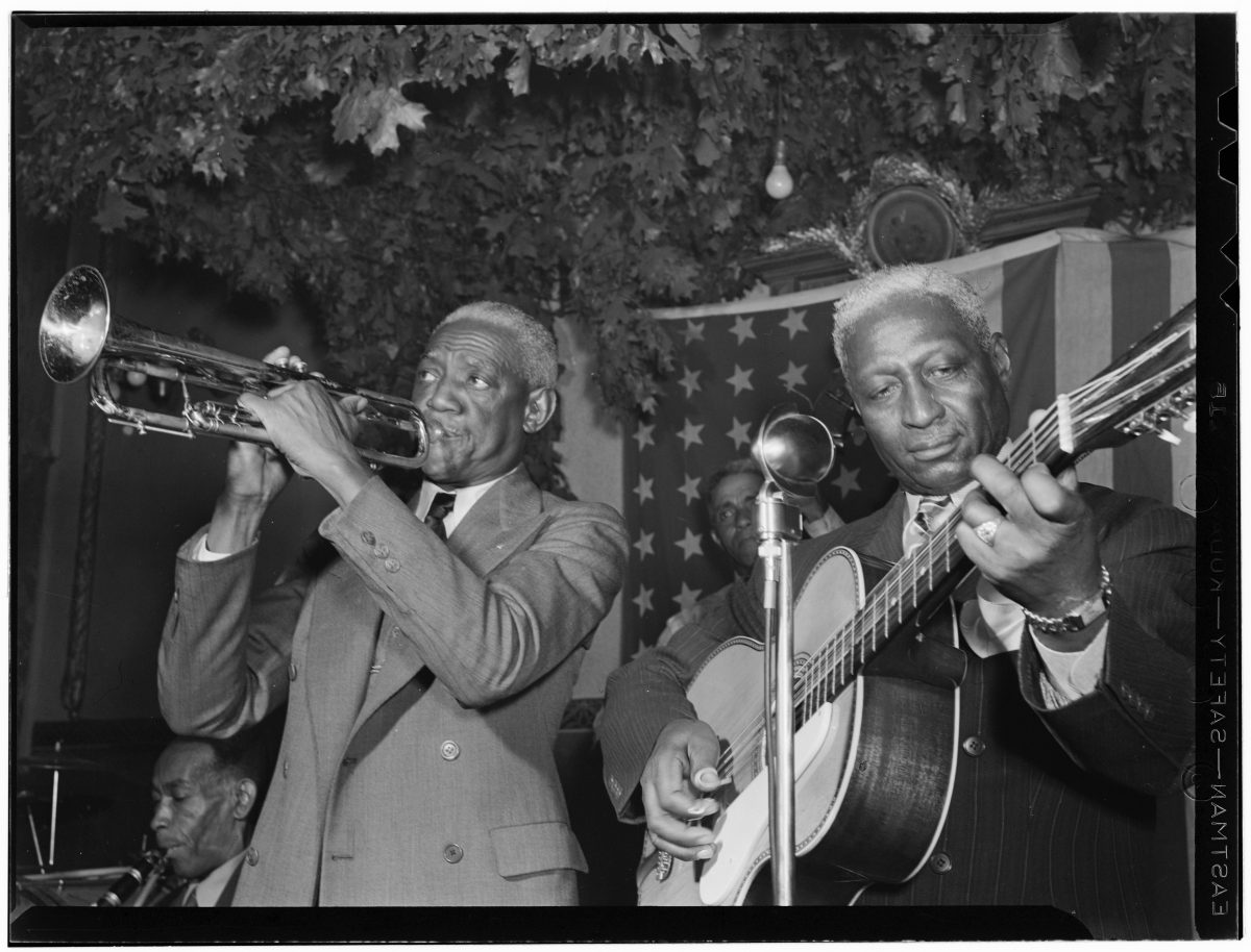 Portrait of Bunk Johnson, Leadbelly, George Lewis, and Alcide Pavageau, Stuyvesant Casino, New York, N.Y., ca. June 1946] Other Title Caption from Down Beat: Leadbelly sits in with Bunk's band Alternate Title Caption from Down Beat: Leadbelly sits in with Bunk's band Contributor Names Gottlieb, William P. -- 1917- (photographer)