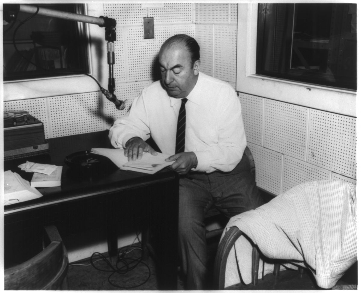 "Photograph shows Chilean poet Pablo Neruda, seated at a table in front of a microphone in the Library of Congress Recording Laboratory, Studio B, Washington, D.C., during the recording of his poem ""Alturas de Macchu Picchu"" for the Archive of Hispanic Literature on Tape. Created / Published [Washington, D.C.], [20 June 1966]"