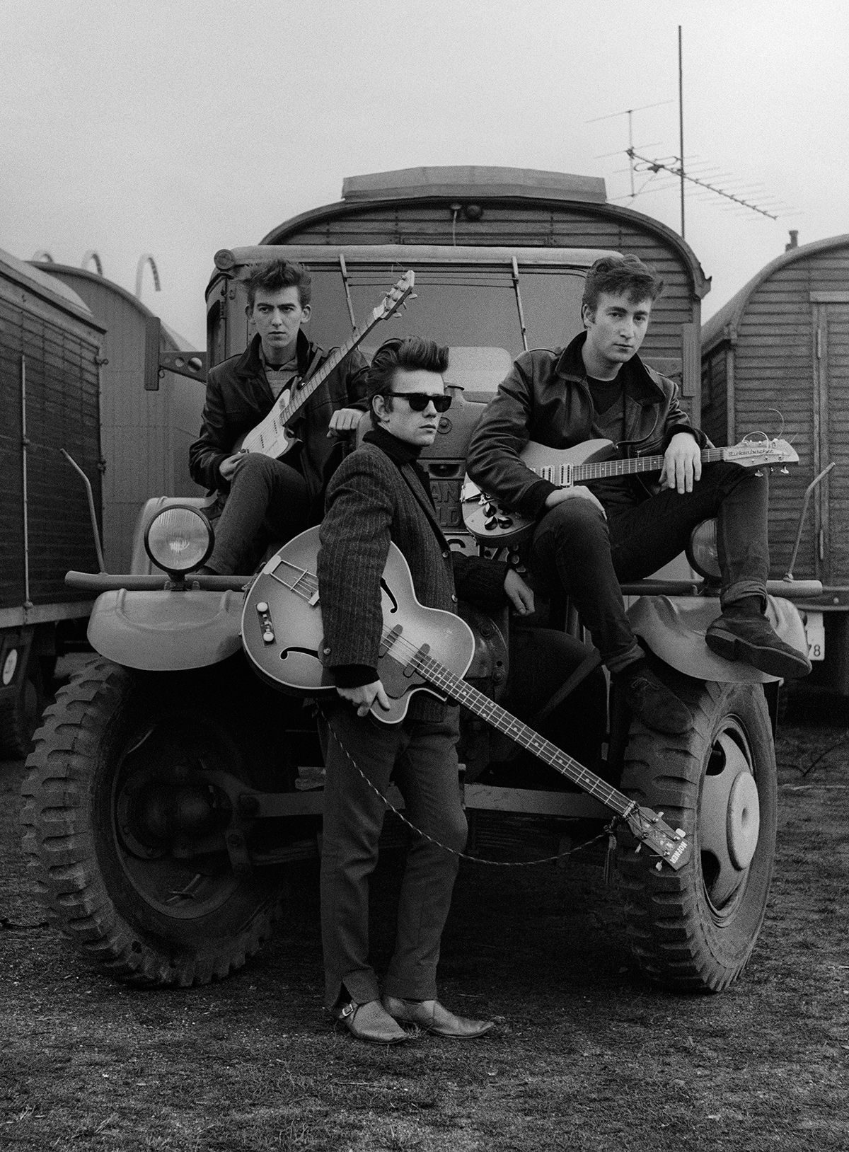 Astrid Kirchherr, John Lennon, Stuart Sutcliffe and George Harrison on a truck at the fairground, 1960 the beatles