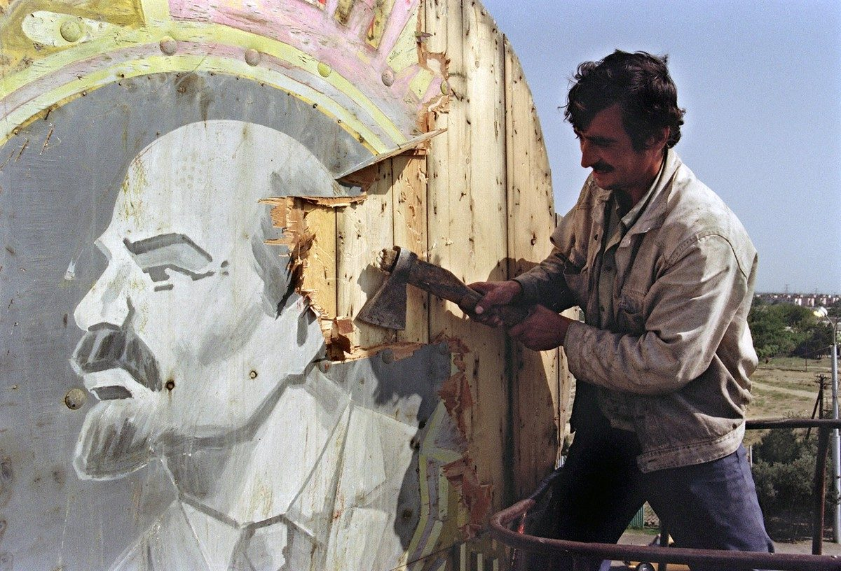 A Baku resident uses an axe to hack apart a placard showing a portrait of Russian Bolshevik revolutionary leader Vladimir Lenin, on September 21, 1991. Azerbaijan was proclaimed a Soviet Socialist Republic by Soviet Union in 1920. The Azeri National Council voted for its declaration of independence in 1991.