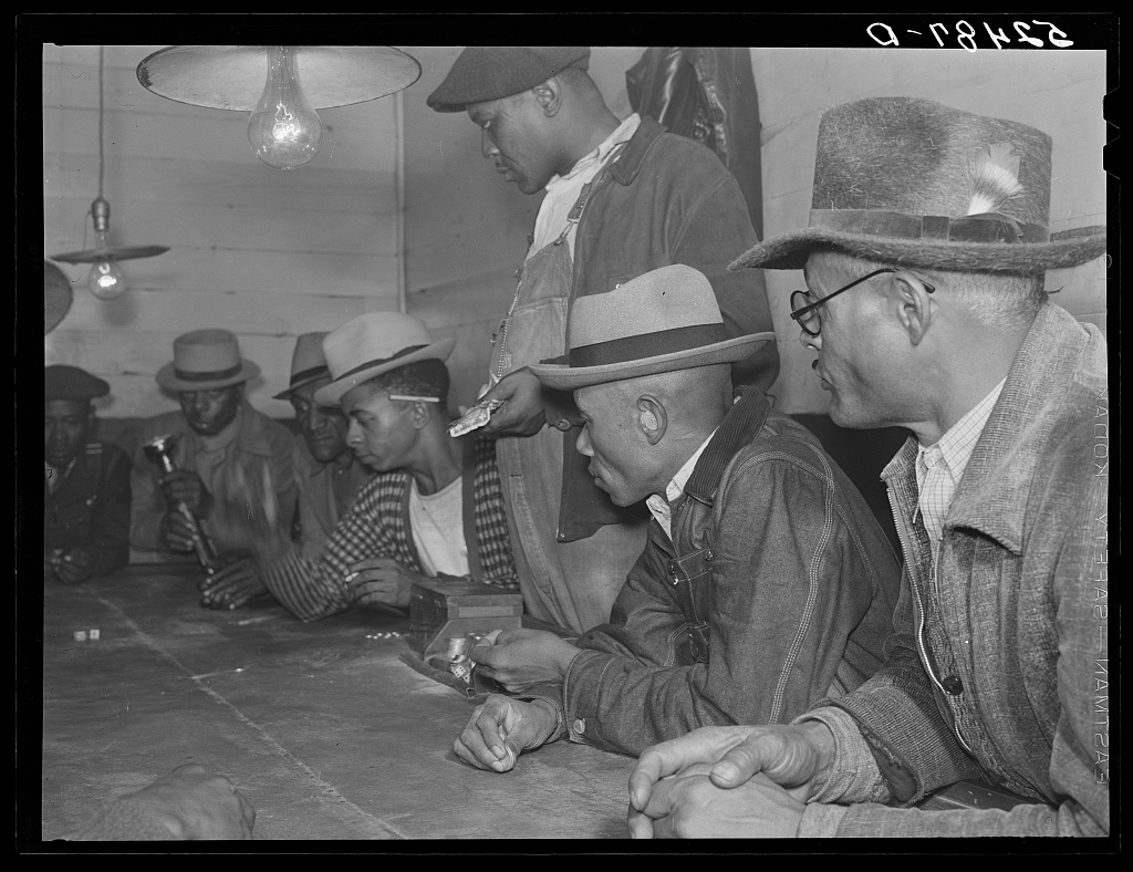 Negroes gambling with their cotton money in a juke joint outside of Clarksdale, Mississippi Delta Contributor Names Wolcott, Marion Post, 1910-1990, photographer Created / Published 1939 Nov.