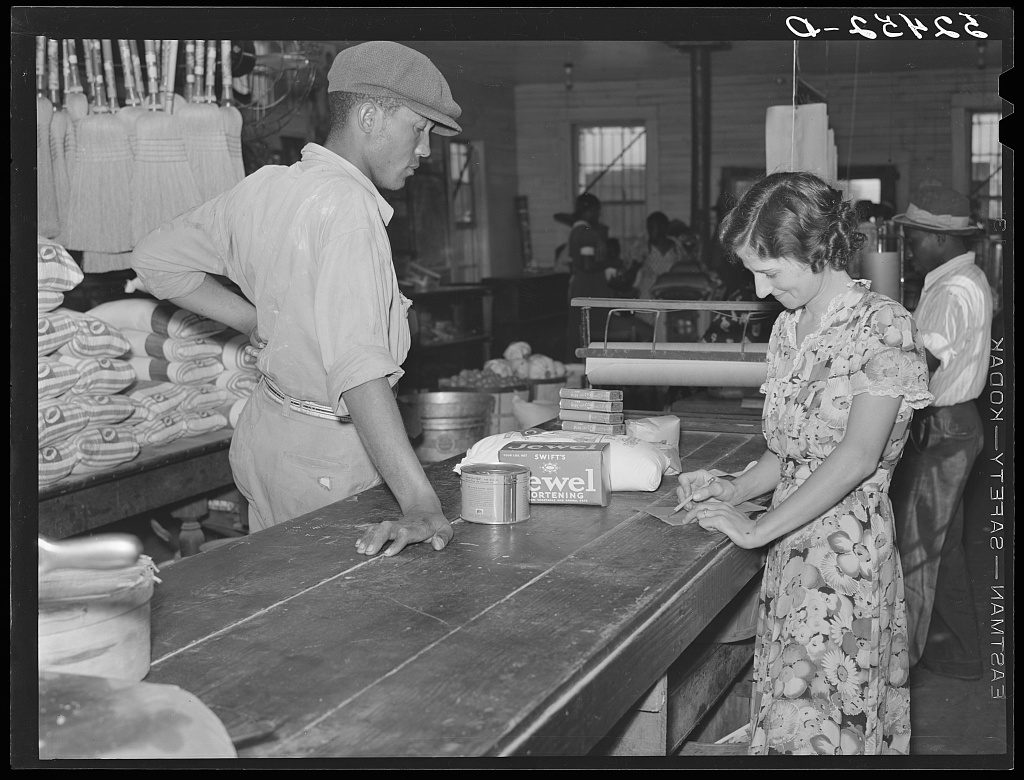 wagehand purchasing groceries after being paid off on Saturday in plantation store. Mileston Plantation, Mississippi Delta Contributor Names Wolcott, Marion Post, 1910-1990, photographer Created / Published 1939 Nov.