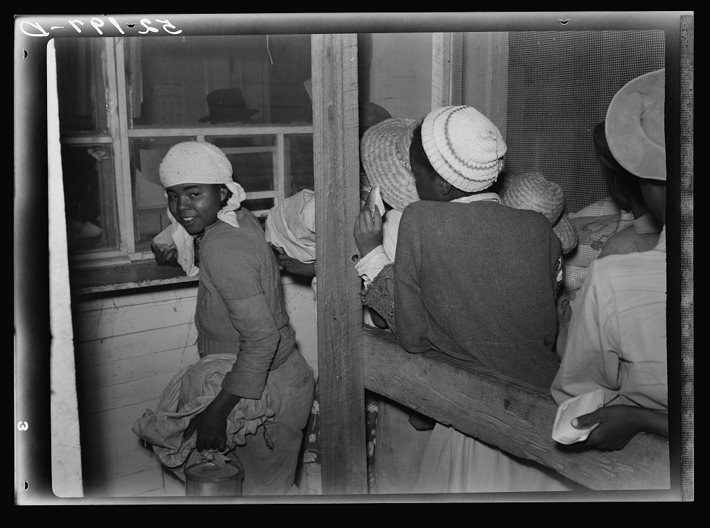 Negro day laborers brought in truck from nearby towns, waiting to be paid off for cotton picking and buy supplies inside plantation store on Friday night. Marcella Plantation. Mississippi Delta. Mississippi Contributor Names Wolcott, Marion Post, 1910-1990, photographer Created / Published 1939 Nov.