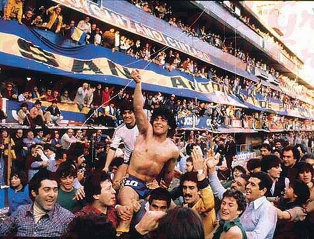 Maradona being held aloft by fans of Boca Juniors after winning the 1981 Metropolitano championship