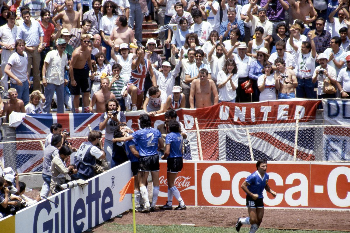 MB2A55 FIFA World Cup - Mexico 1986 22.6.1986, Estadio Azteca, Mexico, D.F. Quarter-final Argentina v England. Diego Maradona celebrates after scoring the greatest goal the World Cup has ever seen, 2-0 against England. English fans in the stand don't seem to agree.