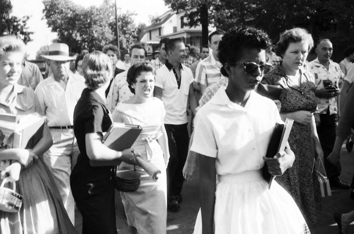 "Segregationist protestors surround Elizabeth Eckford, one of nine black students to integrate Central High School in Little Rock, Arkansas, 1957. Reflecting on the experience decades later, Ms. Eckford observed, ""True reconciliation can occur only when we honestly acknowledge our painful, but shared, past."" (Will Counts Collection: Indiana University Archives)"