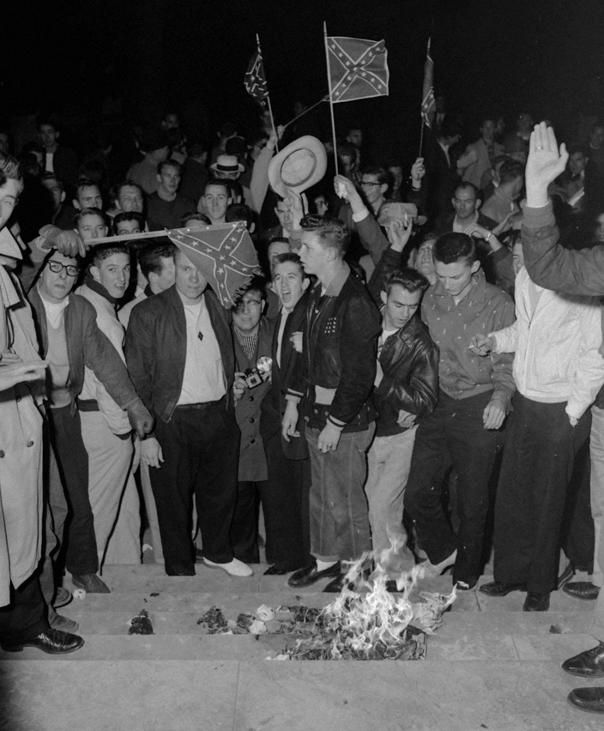 Students at the University of Alabama burn desegregation literature in Tuscaloosa, Alabama, on February 6, 1956, in response to the enrollment of Autherine Lucy. (Library of Congress/AP)