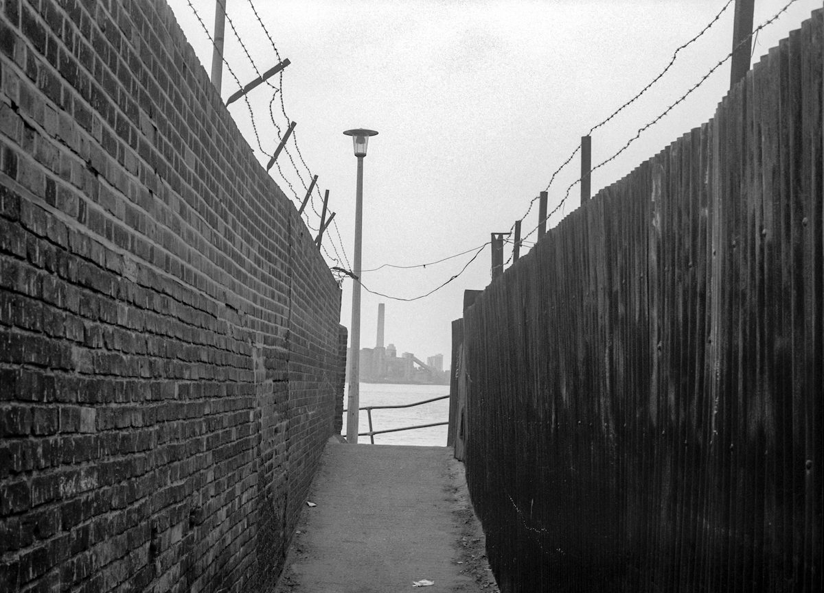 Riverside path, River Thames and view of Deptford Power Station, Greenwich. 1980