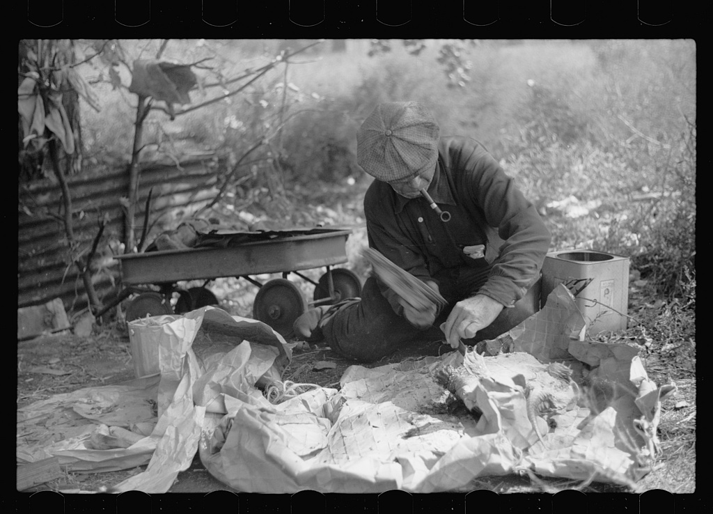 Man in hobo jungle killing turtle to make soup, Minneapolis, Minnesota] Contributor Names Vachon, John, 1914-1975, photographer Created / Published [1939 Sept.]