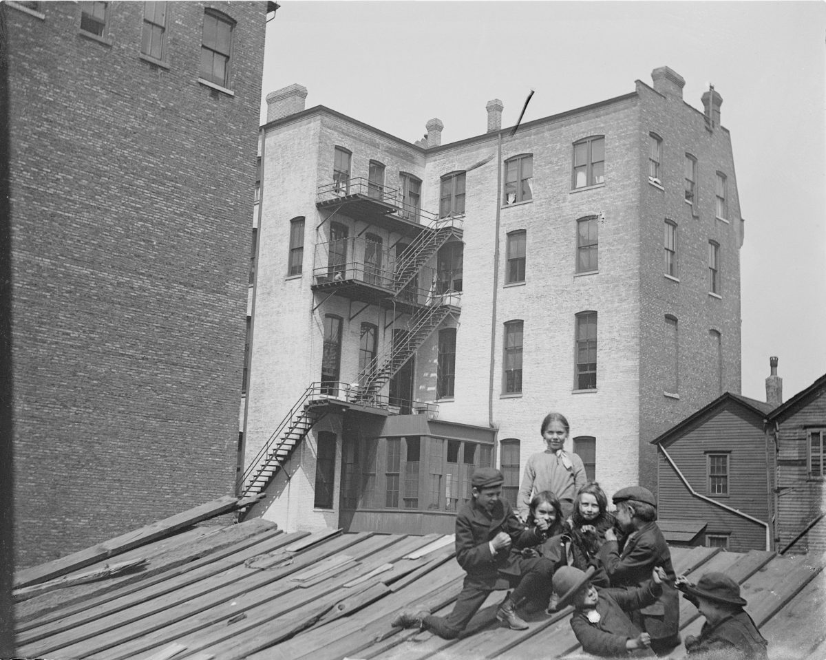 Children sitting on the roof of a buildingGeorge Silas Duntley Photographs 1899-1918