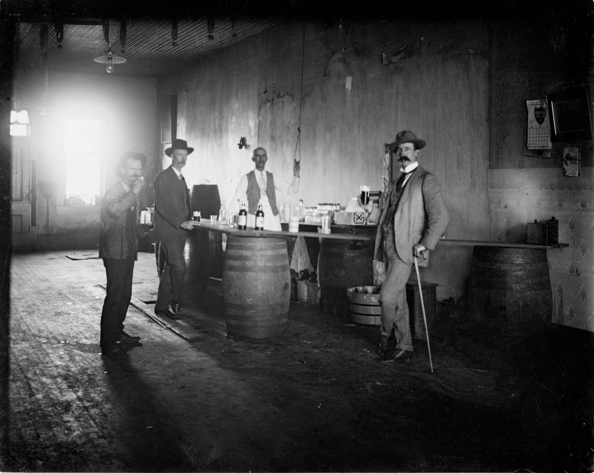 Four men drinking in a barGeorge Silas Duntley Photographs 1899-1918