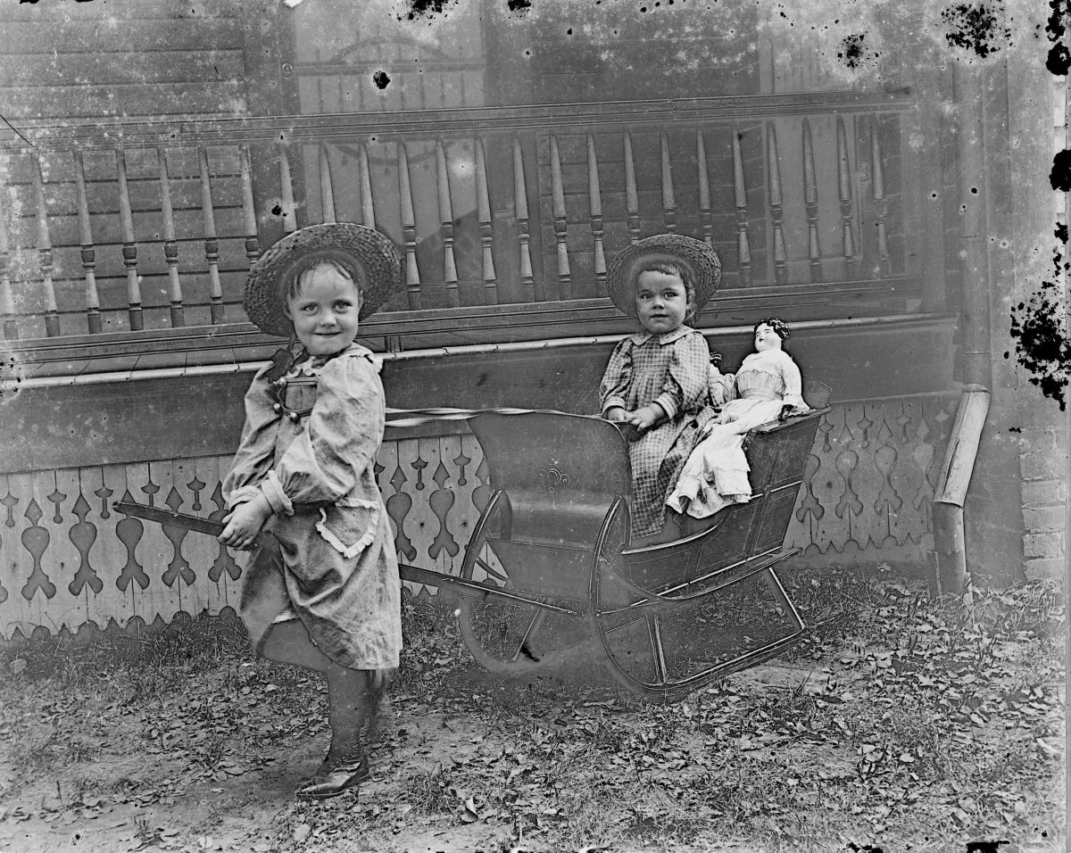 Girls playing outside with sled (2)George Silas Duntley Photographs 1899-1918