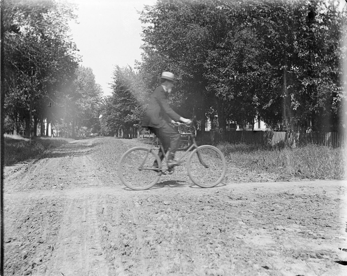 Man riding a bicycle - George Silas Duntley Photographs 1899-1918