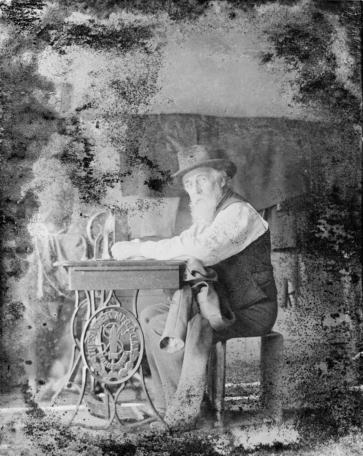 Man working at sewing machineGeorge Silas Duntley Photographs 1899-1918