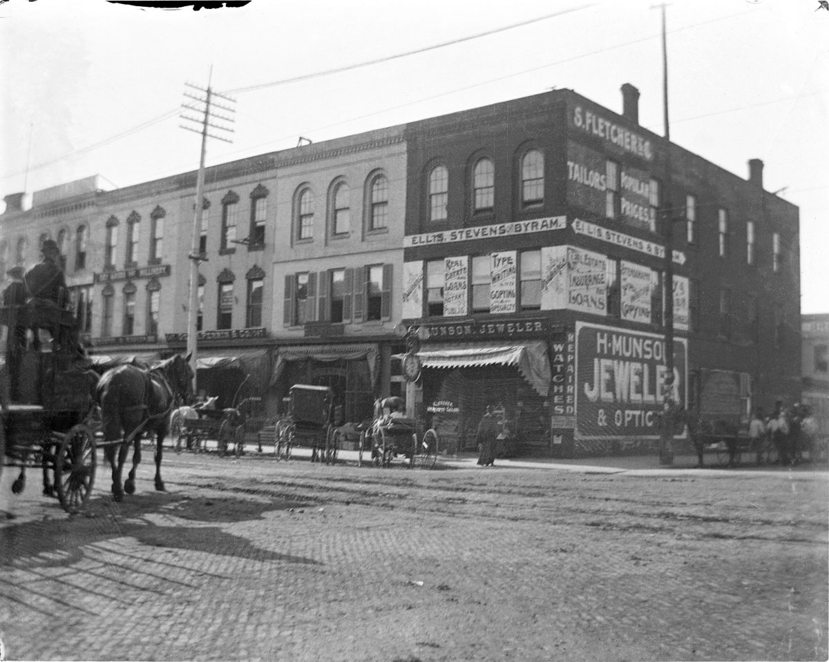 Street view with H. Munson Jeweler and Optics on cornerGeorge Silas Duntley Photographs 1899-1918