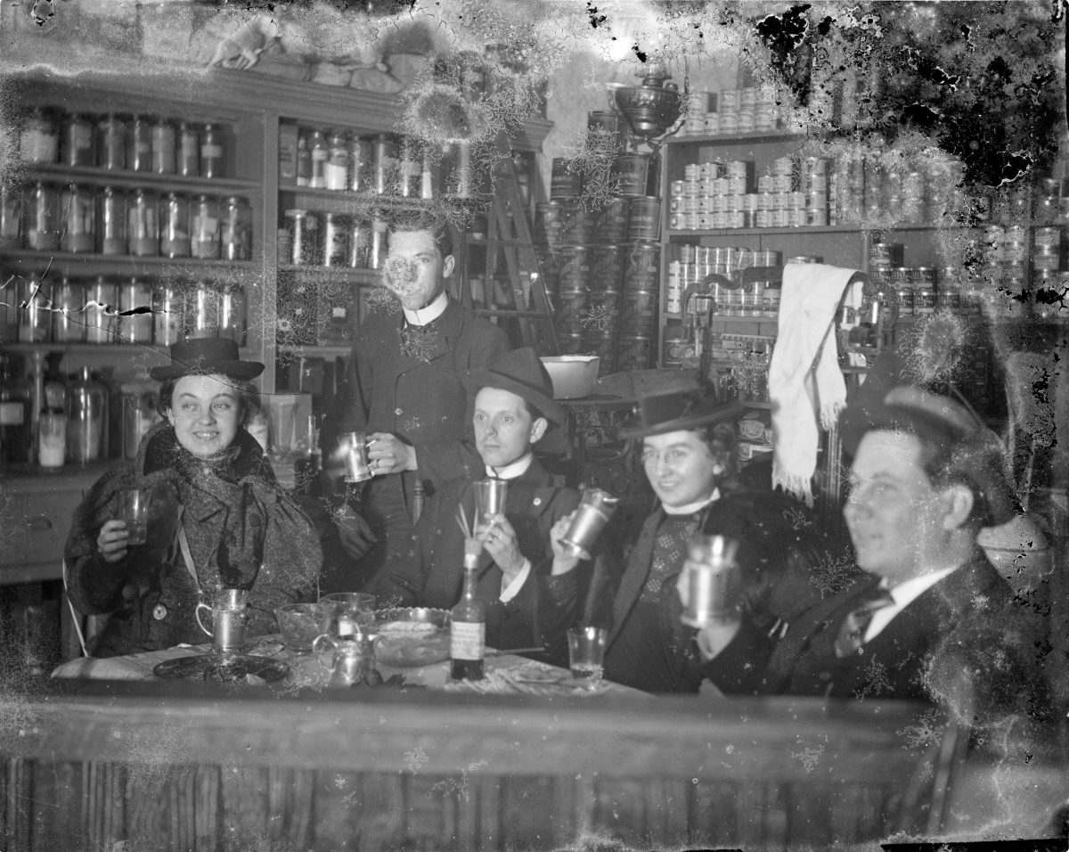 Three men and two women drinking in a shopGeorge Silas Duntley Photographs 1899-1918