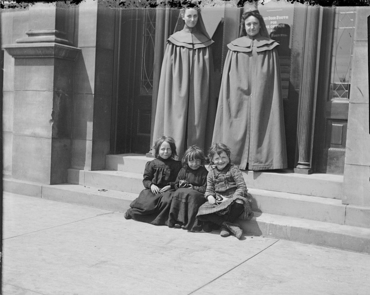 Two women and three girls seated in front of St. Luke's HospitalGeorge Silas Duntley Photographs 1899-1918