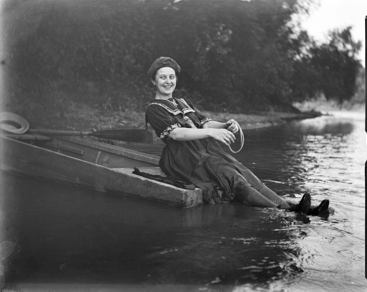 Unidentified woman sitting on the back of row boat with feet in waterGeorge Silas Duntley Photographs 1899-1918