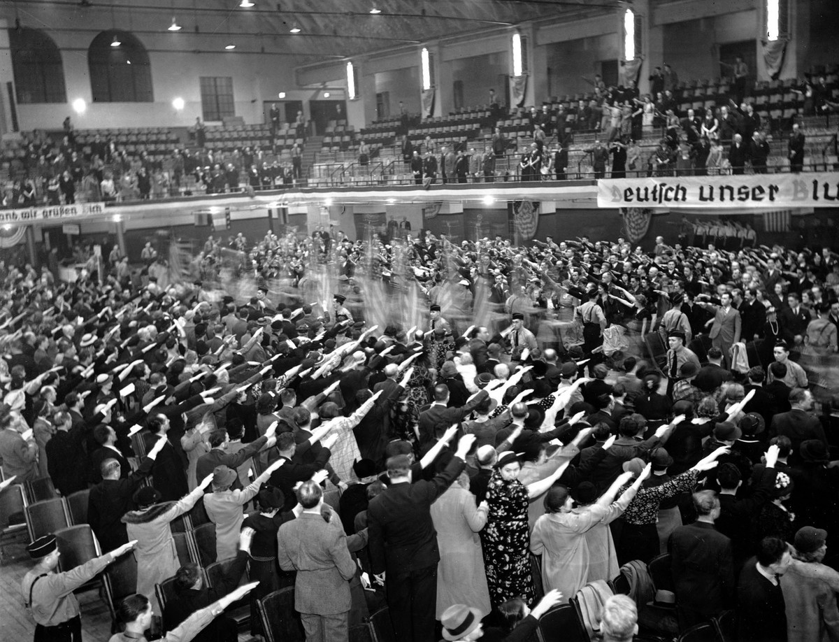 Pro-Nazi members of various singing and gymnastic societies salute a procession of flags at White Plains Hall in New York in the 1930s. They were gathered for a German Day celebration. The German-American Bund disclaimed this large group
