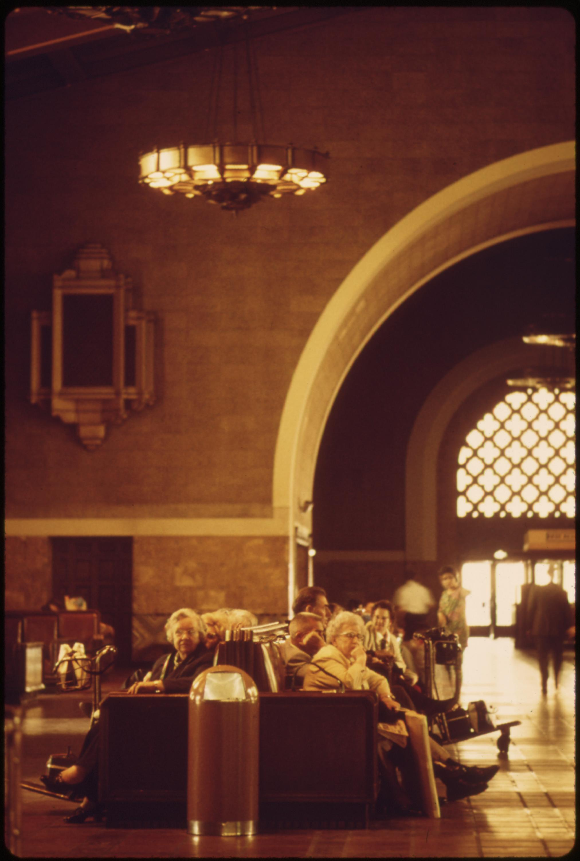 Amtrak passengers waiting for passenger trains in the interior of the Los Angeles Union Passenger Terminal, which was built for the 1932 Summer Olympics in that California city, May 1974
