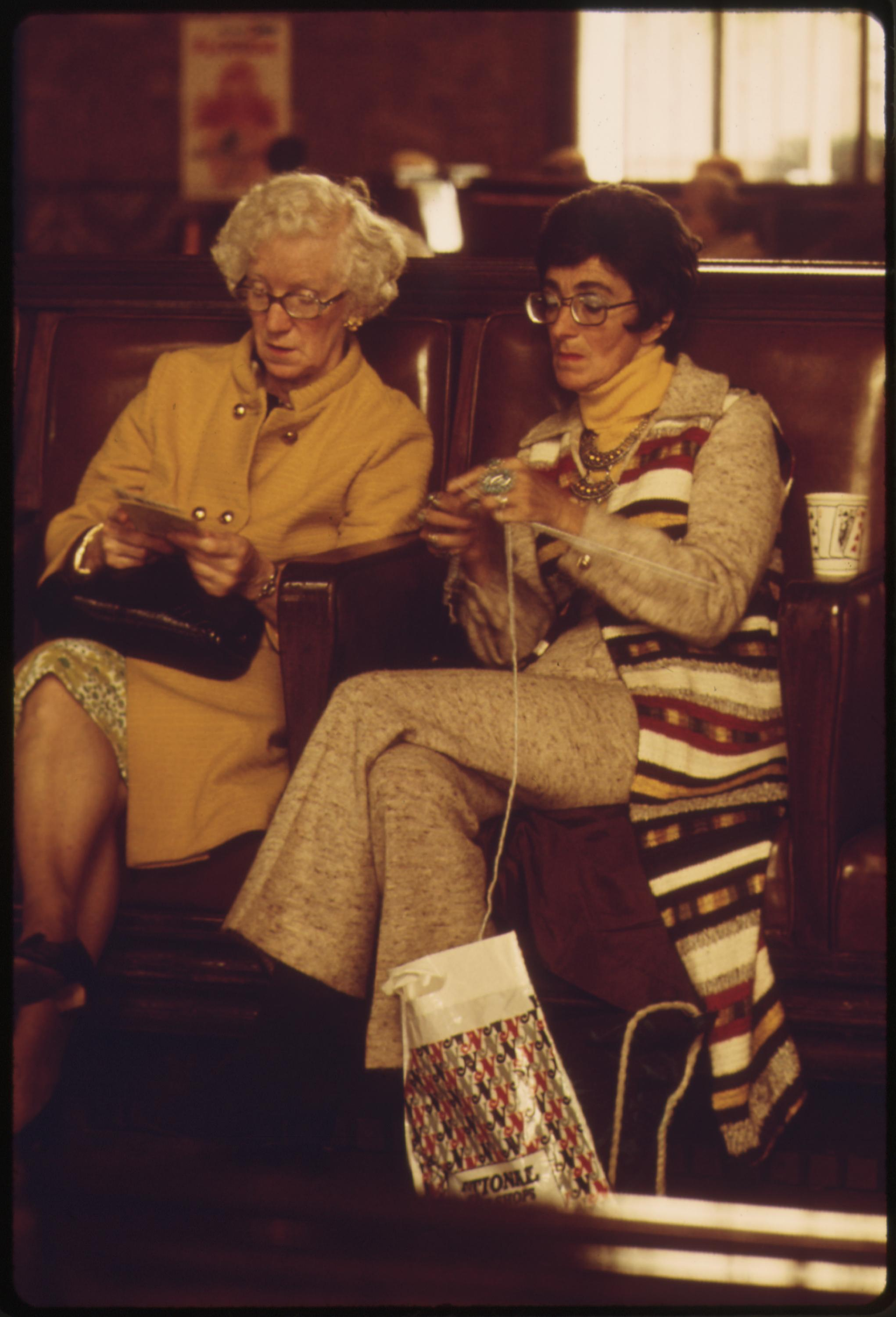 Amtrak train passengers pass the time before boarding at the Los Angeles Union Passenger Terminal, May 1974