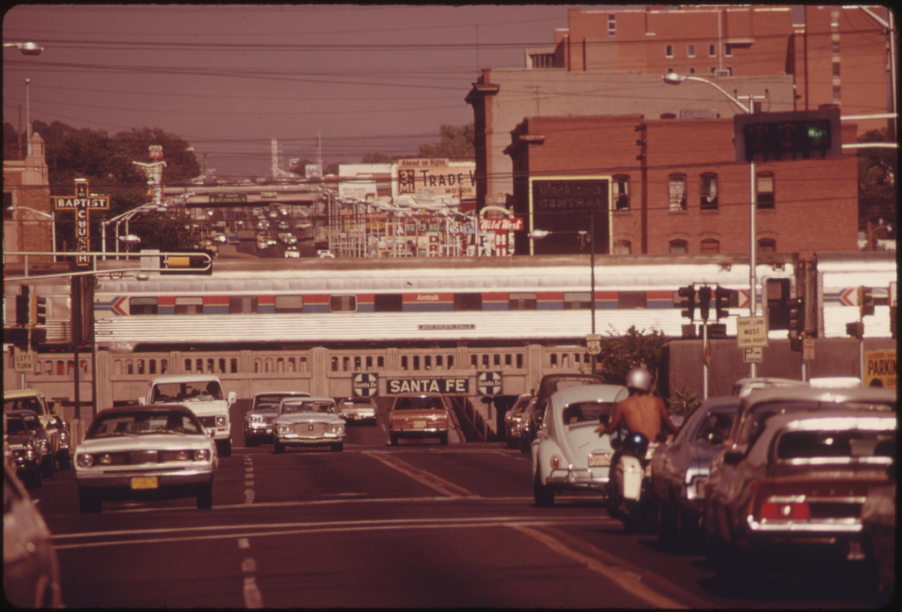 Amtrak's Southwest Limited crossing central avenue in downtown Albuquerque, New Mexico, on its trip from Los Angeles California, to Chicago, June 1974