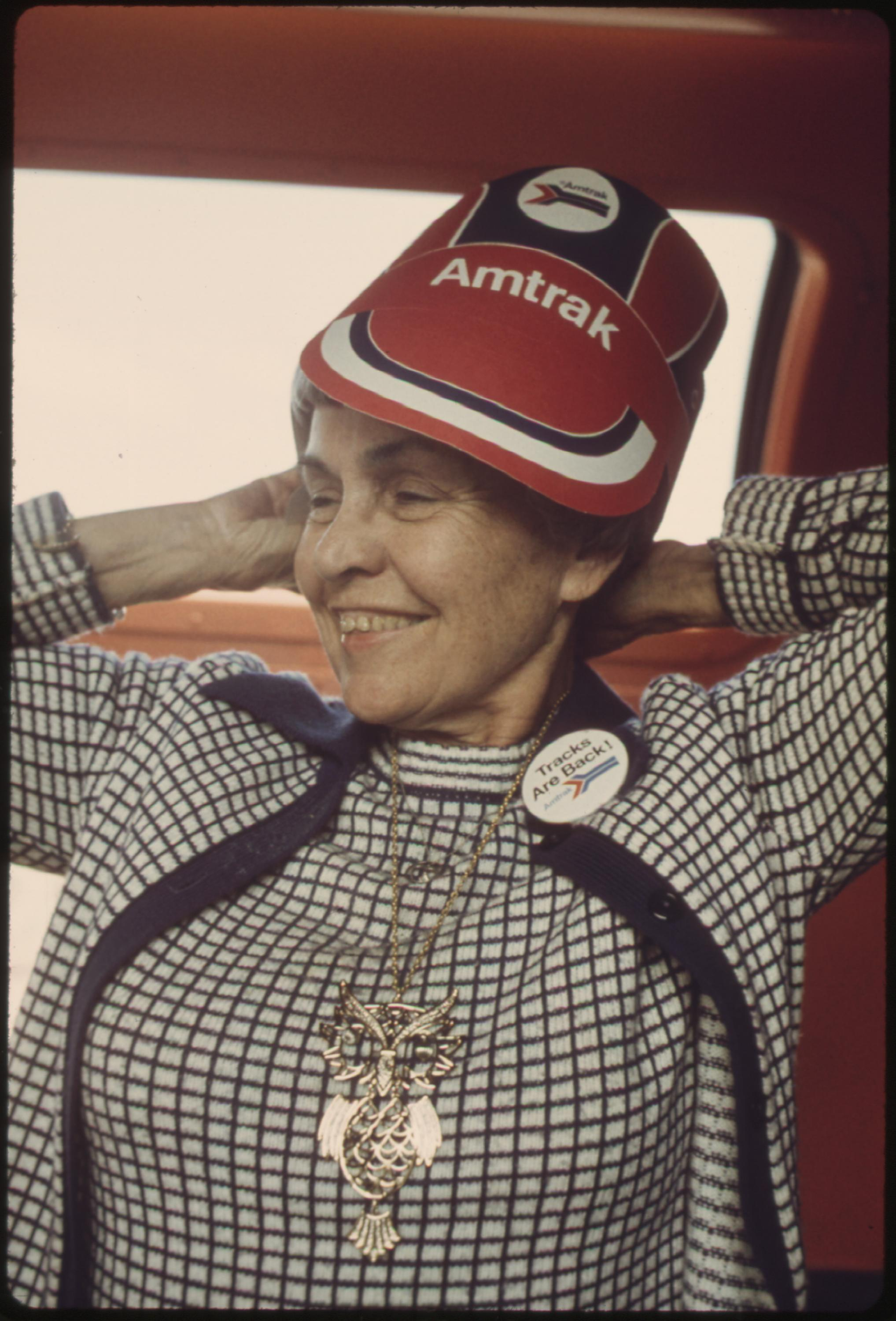An Amtrak eyeshade and a Tracks are Back! pin are worn by a passenger on the Southwest Limited train enroute between Albuquerque, New Mexico, and Dodge City, Kansas, June 1974