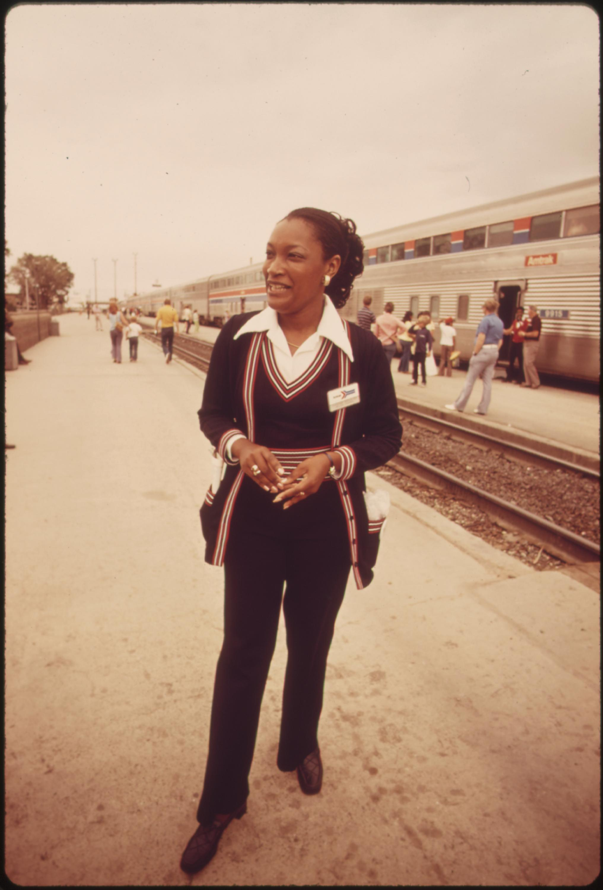 An Amtrak passenger service representative stands ready to answer questions concerning train travel, June 1974