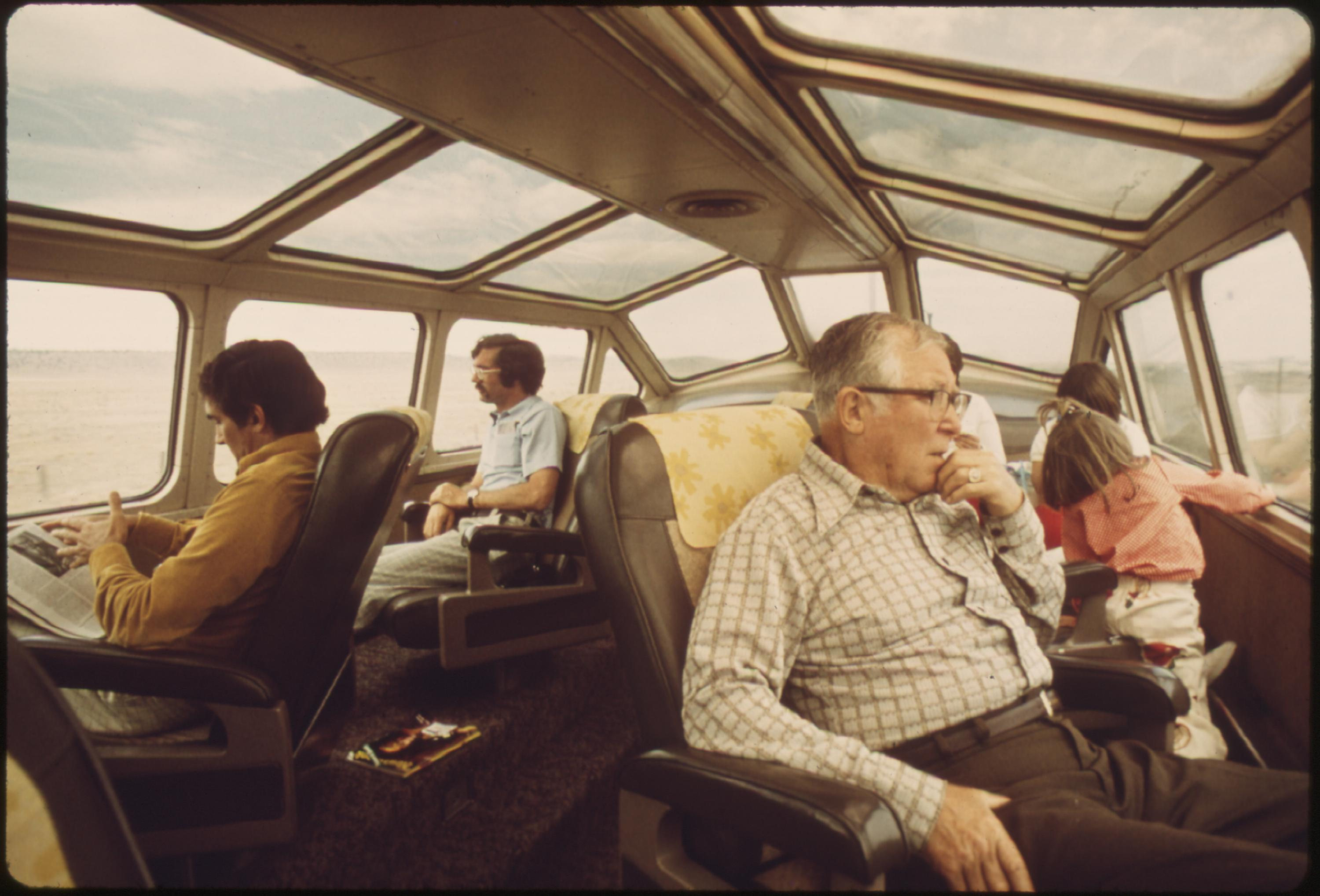 Arizona and New Mexico scenery attract passengers to the dome car of the Southwest Limited, an overnight train from Los Angeles, California, to Albuquerque, New Mexico, June 1974