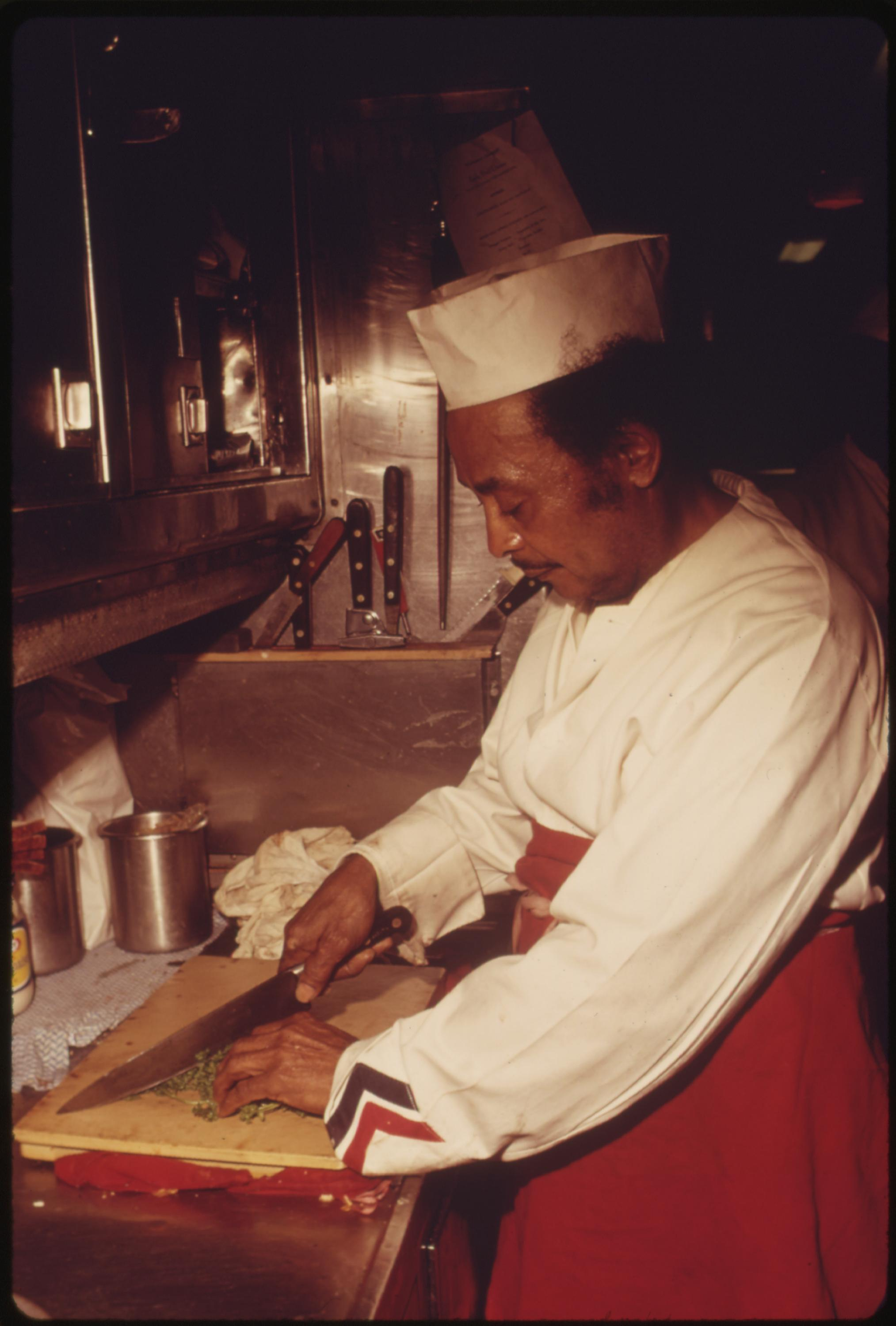 Cook in the galley of the dining car on Amtrak's Southwest Limited, June 1974