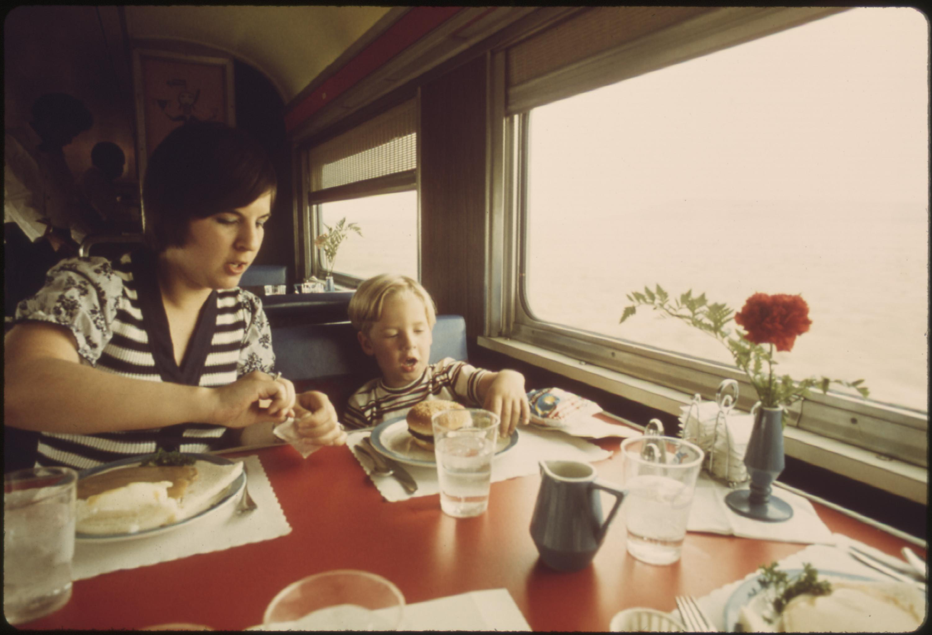 Dining car offers fresh flowers and good food on the Southwest Limited, an Amtrak train between Los Angeles, California and Chicago, June 1974