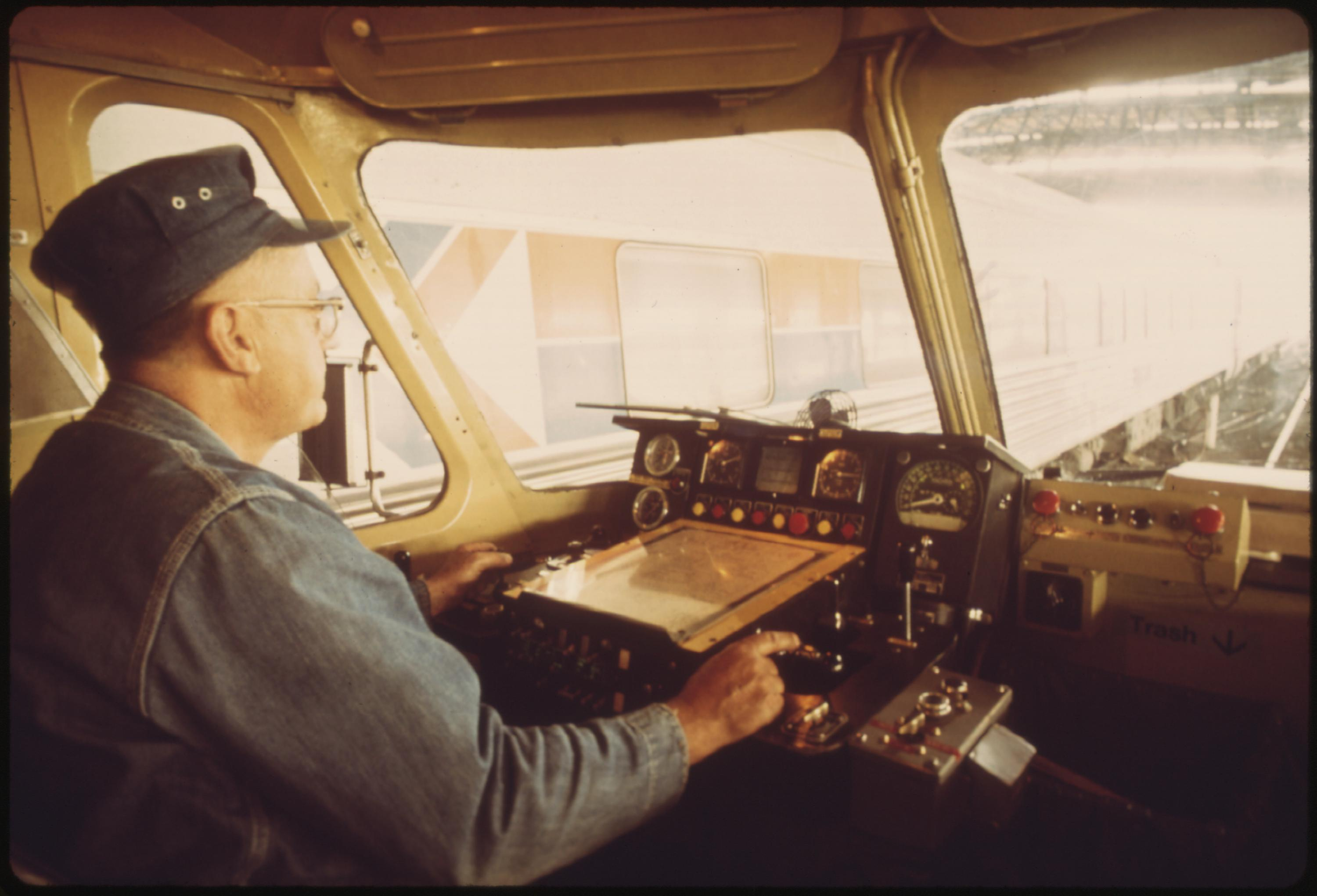 Engineer at the controls of the Amtrak turboliner passenger train at St. Louis, Missouri, June 1974