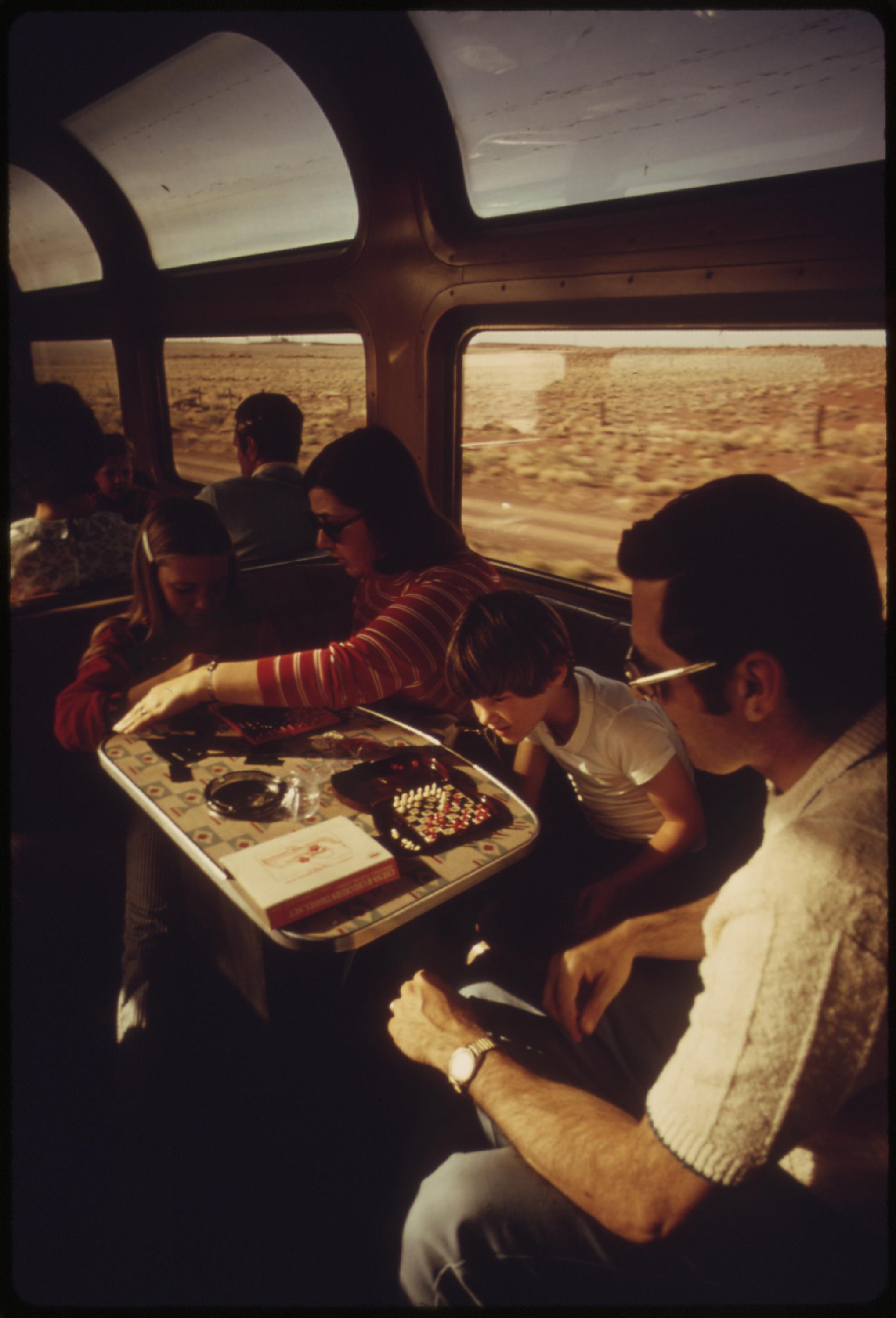 Lounge car on the Southwest Limited Amtrak train helps a family pass the time, June 1974
