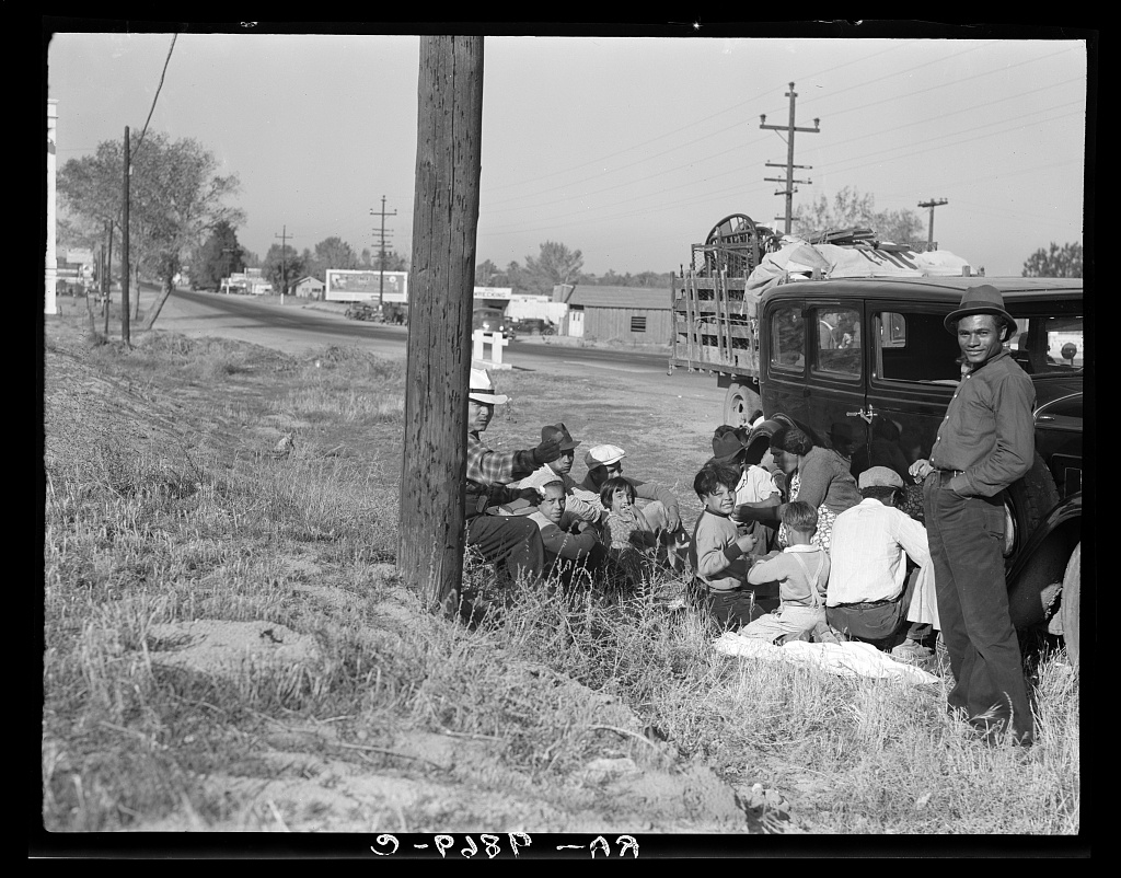 Mexicans bound for the Imperial Valley to harvest peas near Bakersfield, California - Dorothea Lange 1936