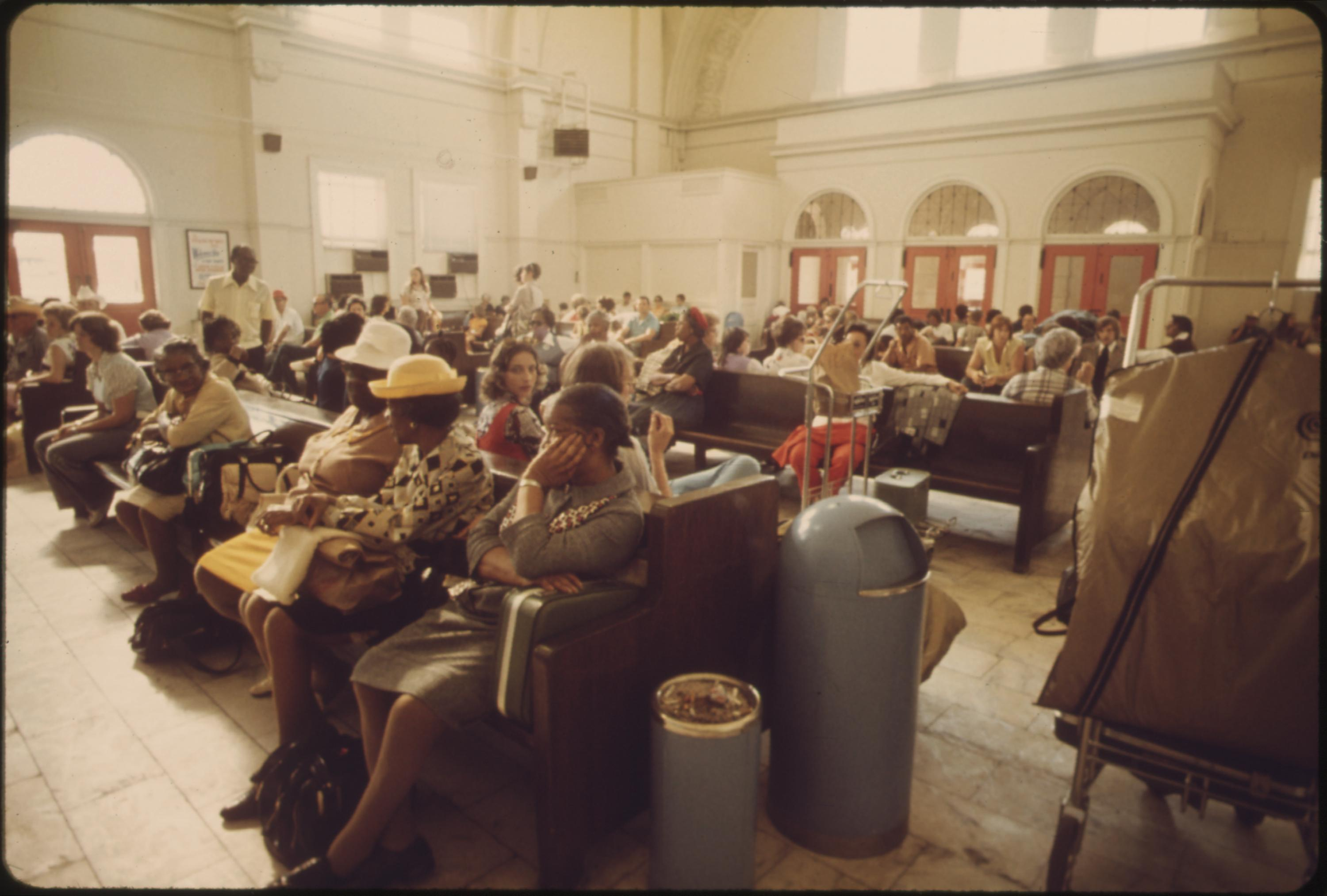 Passengers waiting for a train at the Fort Worth, Texas station, June 1974